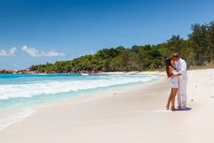 Young couple married laying on sandy beach Royalty Free Stock Photography