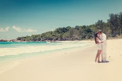 Young couple married laying on sandy beach Stock Images