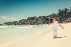 Young couple married laying on sandy beach Royalty Free Stock Images