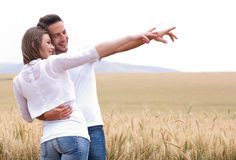 Young couple in meadow Royalty Free Stock Photos