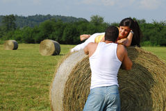 Young couple on the meadow Royalty Free Stock Photos