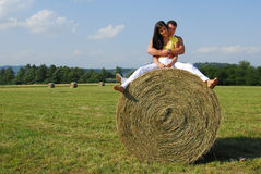 Young couple on the meadow Stock Photo