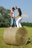 Young couple on the meadow Royalty Free Stock Images
