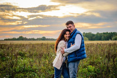 Young couple in a meadow Royalty Free Stock Image