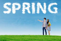 Young couple on meadow at springtime Stock Image