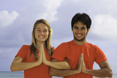 Young couple meditating Royalty Free Stock Image