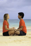 Young couple meditating Stock Photo