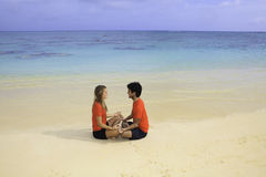 Young couple meditating Royalty Free Stock Images