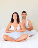 Young couple meditating Stock Photography