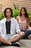 Young couple in meditation Royalty Free Stock Image