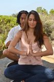 Young couple in meditation Stock Photo