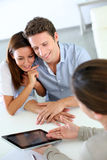 Young couple meeting architect. Future property owners meeting architect for deign of new home Royalty Free Stock Photos