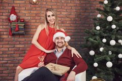 Young couple meeting Christmas hugging home. New Year. Festive mood of a man and a woman Stock Images