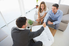Young couple in meeting with a financial adviser Stock Photos