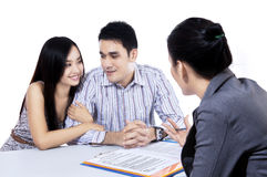 Young couple meeting financial consultant. For credit loan Stock Photography