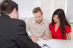 Young couple in a meeting - insurance or bank Stock Photography