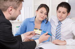 Young couple in a meeting - insurance or bank stock photos