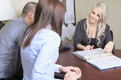 Young couple in a meeting - insurance or bank for Stock Photography