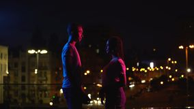 Young couple meeting in night city, falling in love at first sight, fate concept stock video footage