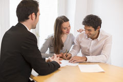 Young Couple meeting real-estate agent to buy property. Woman men advisor office house investment stock images