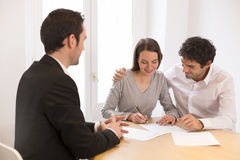 Young Couple meeting real-estate agent to buy property. Woman men advisor office house investment royalty free stock images