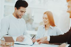 Young Couple Meeting With Rieltor. Bright Office. Young Couple. Meeting With Rieltor Concept. Bright Office. Making A Contract. Buying A Property. Panoramic stock photos