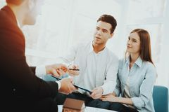 Young Couple Meeting With Rieltor. Bright Office. Young Couple. Meeting With Rieltor Concept. Bright Office. Making A Contract. Buying A Property. Panoramic royalty free stock images
