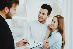 Young Couple Meeting With Rieltor. Bright Office. Young Couple. Meeting With Rieltor Concept. Bright Office. Making A Contract. Buying A Property. Panoramic stock image