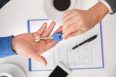 Couple at real estate sales office with agent passing keys top view royalty free stock images