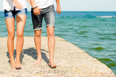 Young couple walking an the sea side Stock Photo