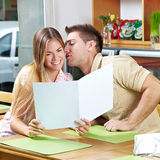 Young couple with menu in café Stock Images