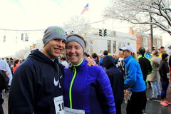 Young couple in middle of throng,getting ready to run the Annual Christopher Dailey Turkey Trot,Saratoga Springs,New York,2014 Stock Image