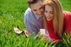 Young couple with mobile phone Royalty Free Stock Photography