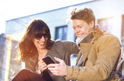 Young couple with mobile phone Royalty Free Stock Photo