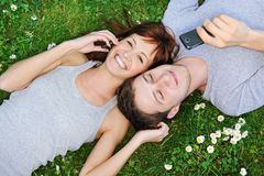 Young couple with mobile phones Royalty Free Stock Image