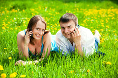 Young couple with mobile phones. Outdoors Royalty Free Stock Photography