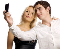 Young couple with mobile telephone Royalty Free Stock Photography