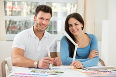 Young couple with model house made up of measurement tape Royalty Free Stock Photo