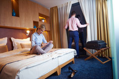 Young couple in modern hotel room Royalty Free Stock Photo