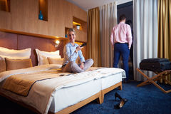 Young couple in modern hotel room Royalty Free Stock Photos