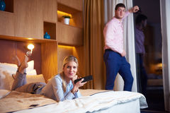 Young couple in modern hotel room Royalty Free Stock Image