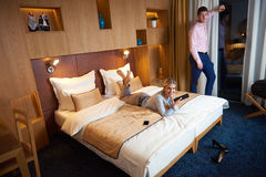 Young couple in modern hotel room Stock Photos