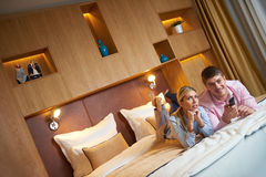 Young couple in modern hotel room Stock Photography
