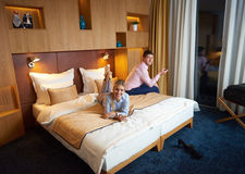 Young couple in modern hotel room Stock Images