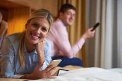 Young couple in modern hotel room Stock Photo