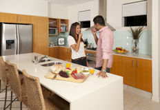 Young couple in modern kitchen. With food platter Royalty Free Stock Images