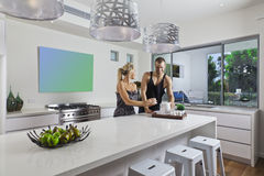 Young couple in modern kitchen Royalty Free Stock Photo