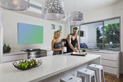 Young couple in modern kitchen Stock Photography