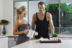Young couple in modern kitchen Royalty Free Stock Photography