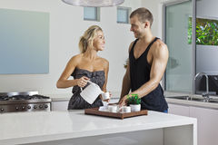Young couple in modern kitchen Stock Photos
